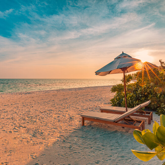 Luxury beach resort, beach loungers near the sea with white sand over sea Topical island background, summer vacation concept, holiday and tourism design. Exotic landscape, inspirational leisure banner